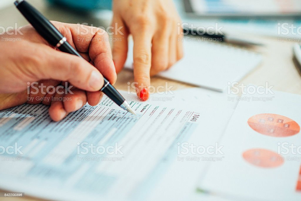 Professionals dealing with taxes and markets stock photo