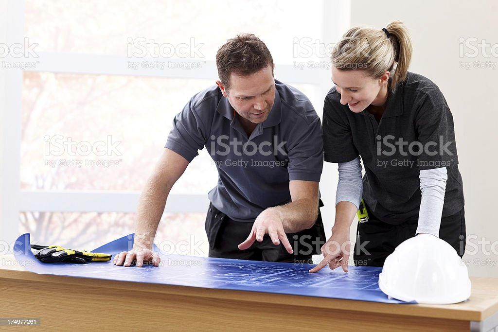 Professionals discussing construction plans royalty-free stock photo