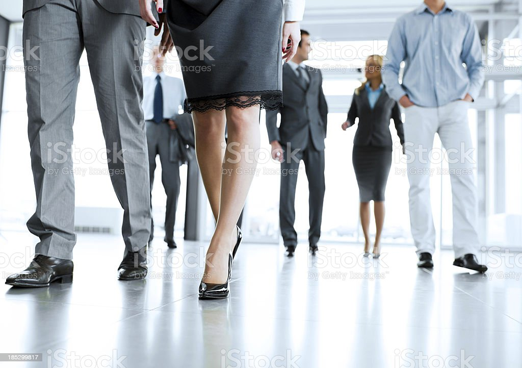 Professionals entering an office building stock photo