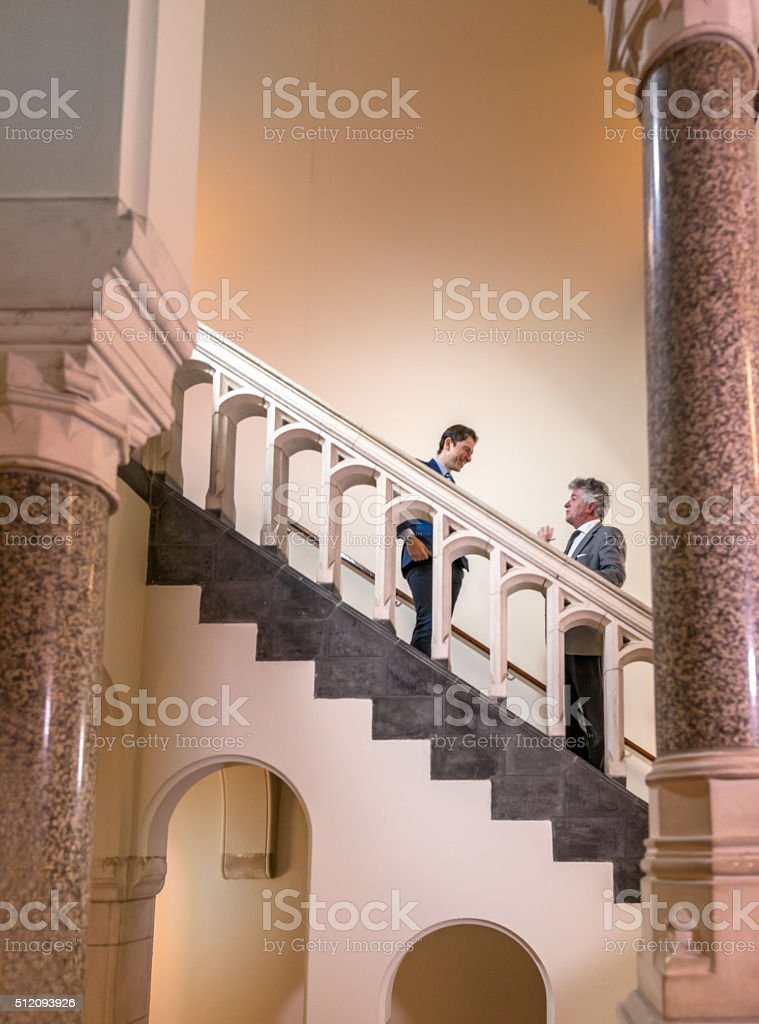 Professionals in Discussion on Staircase stock photo