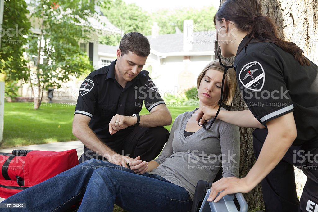EMT Professionals with Patient stock photo