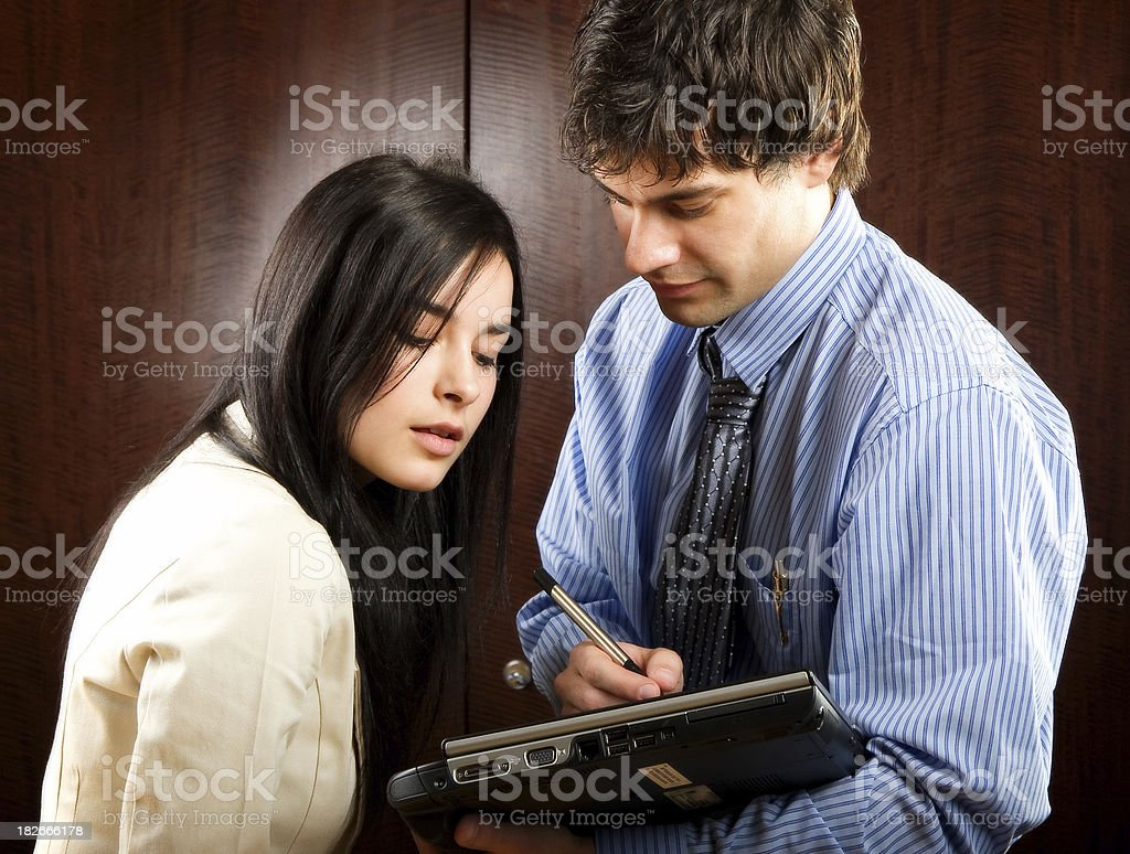 Professionals Writing on Tablet Notebook royalty-free stock photo