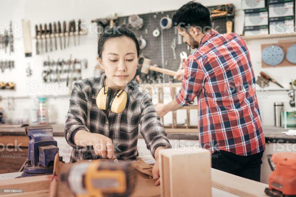 Professionas at woodworking studio stock photo