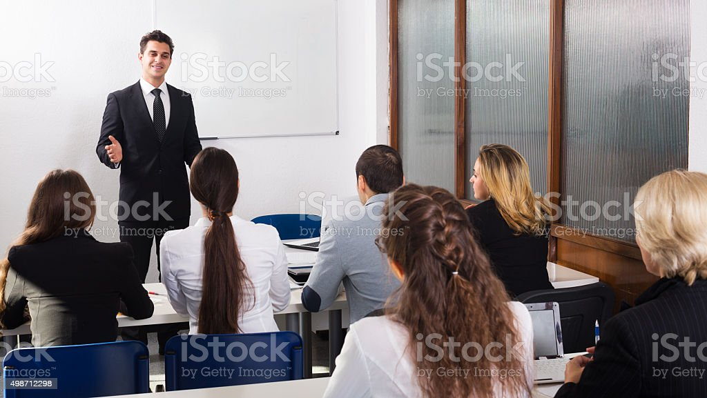 Professor and professionals at courses stock photo