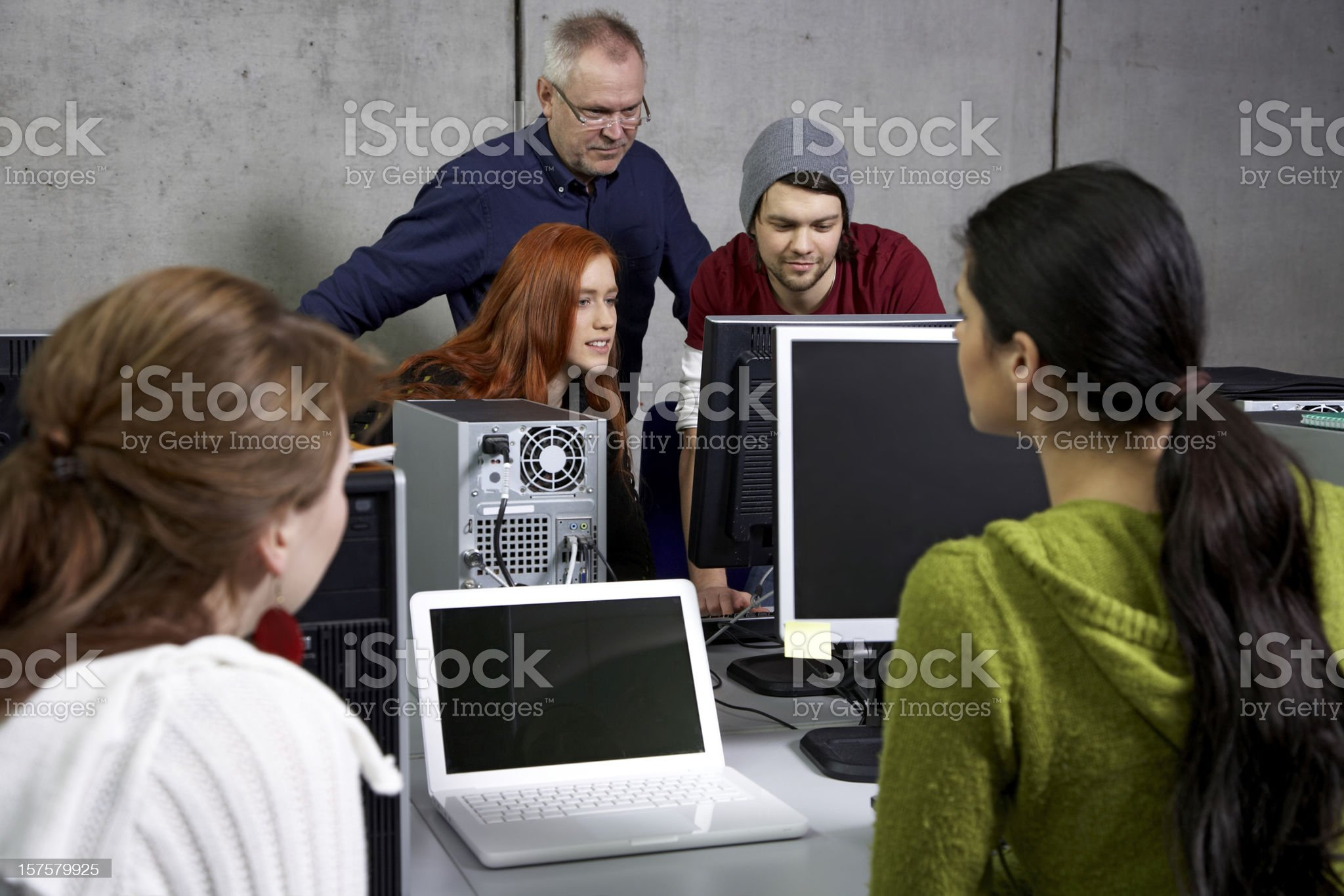 Professor and students in computer lab royalty-free stock photo