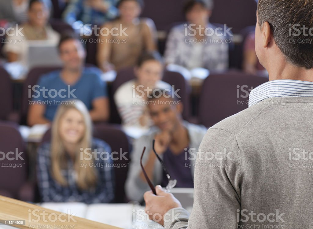 Professor and students in lecture hall royalty-free stock photo