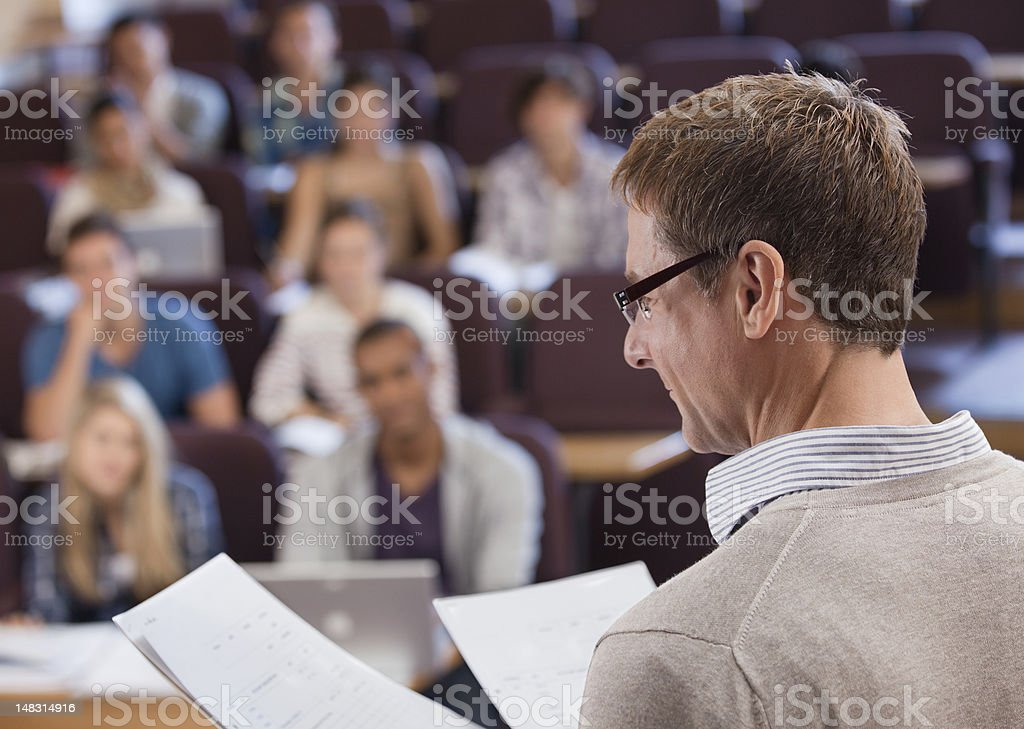 Professor and university students in lecture hall stock photo