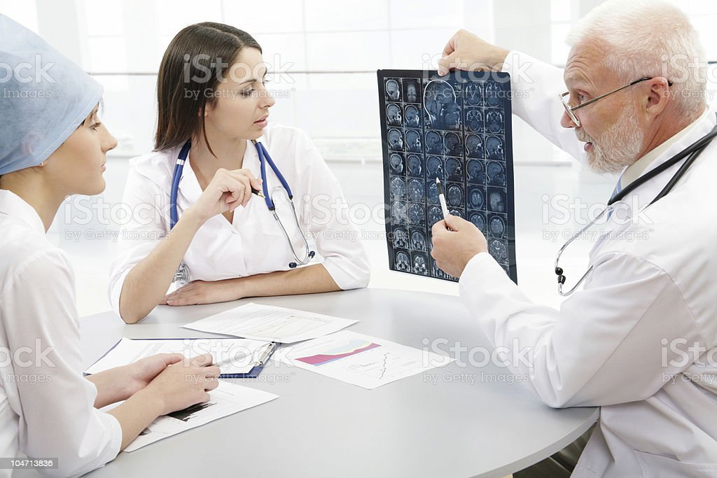 Professor and young doctors royalty-free stock photo