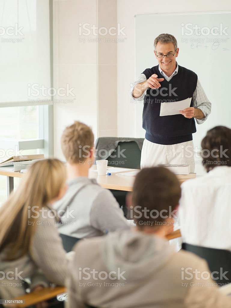 Professor at front of classroom royalty-free stock photo