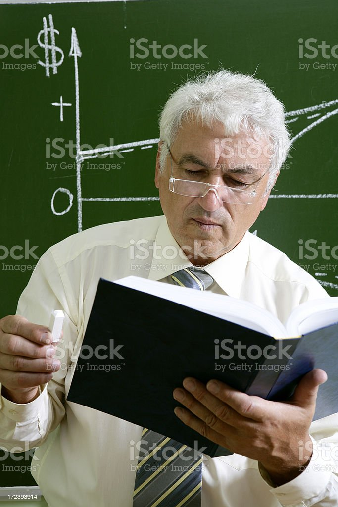 Professor at the blacboard royalty-free stock photo