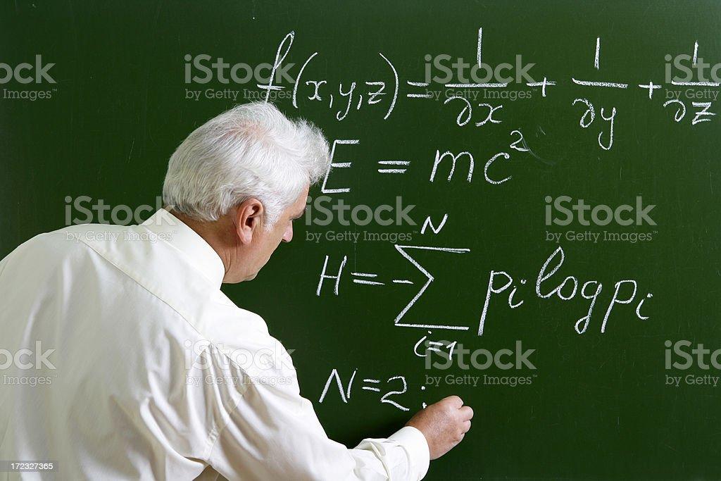 Professor at the blackboard royalty-free stock photo