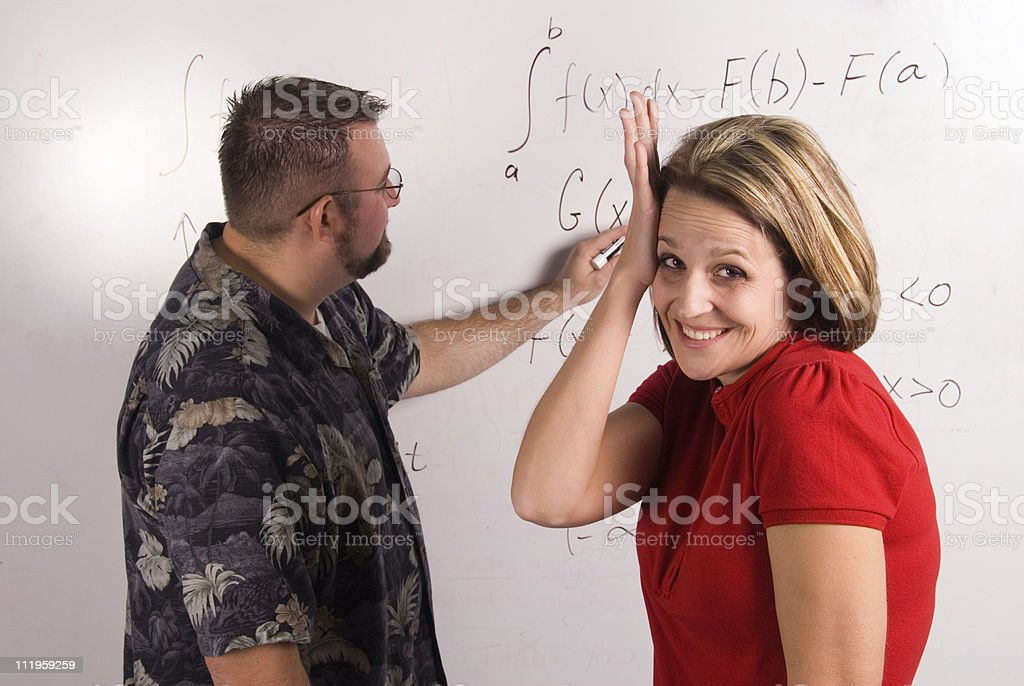 Professor explaning math equation to a confused female student royalty-free stock photo