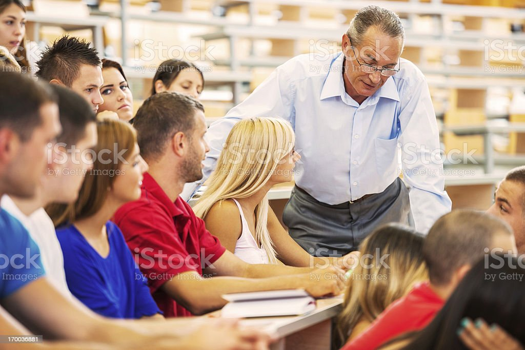 Professor helping a female student. royalty-free stock photo