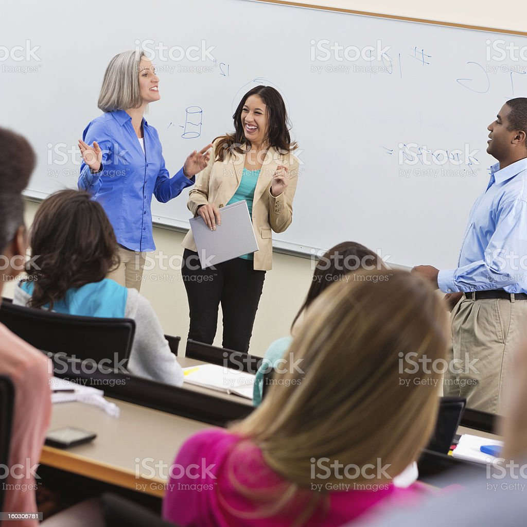 Professor introducing guest speaker in college lecture hall stock photo