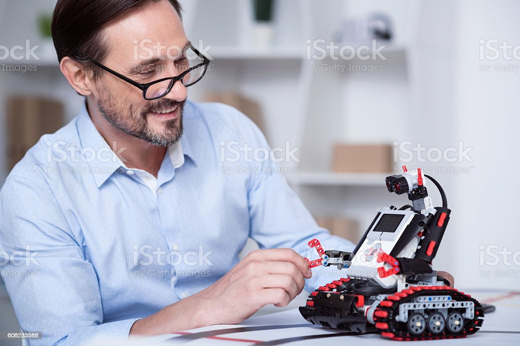 Professor laughing while creating a new machine stock photo