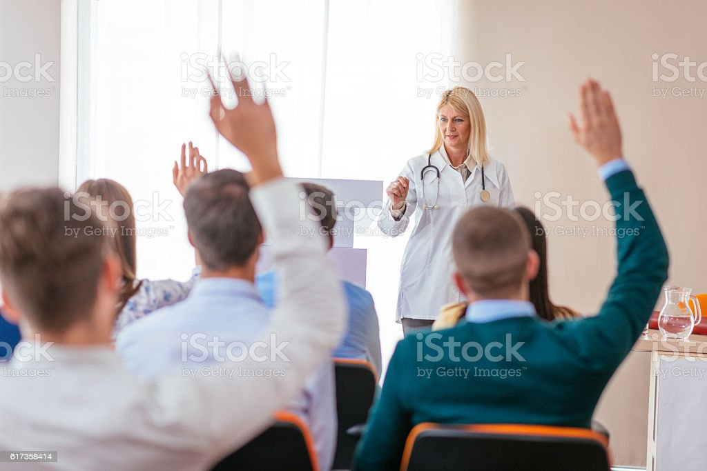 Professor of medicine science with students stock photo