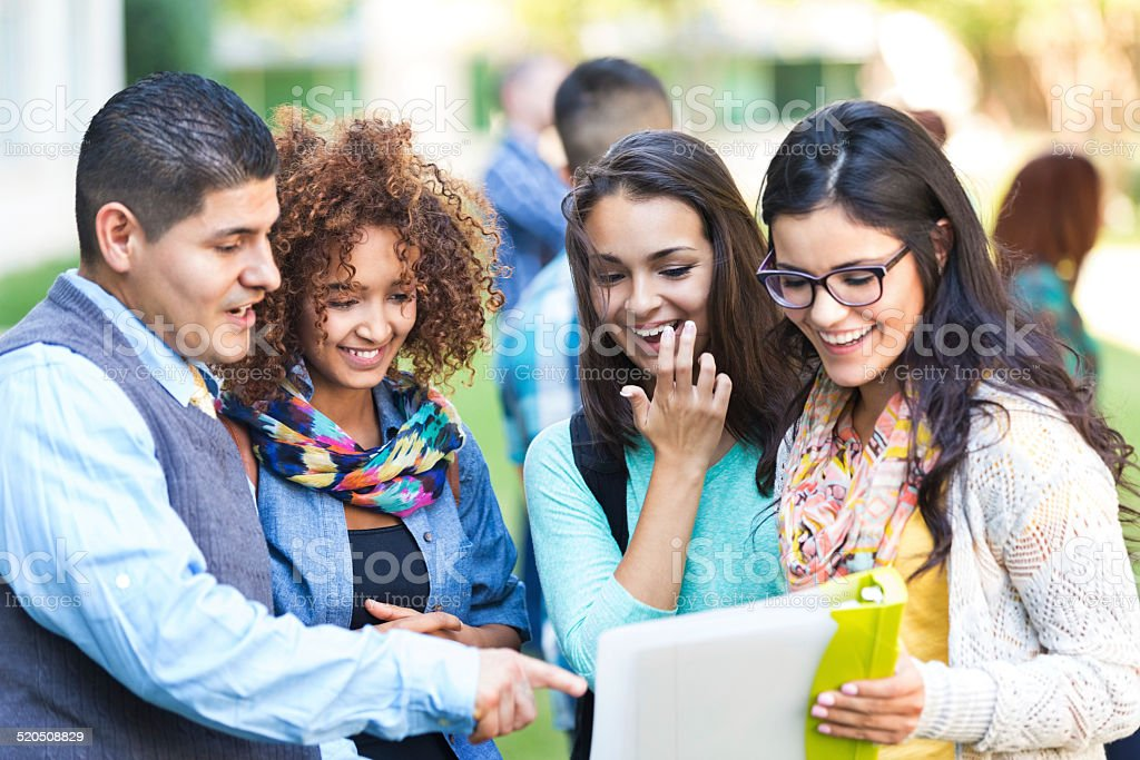 Professor talking to diverse group of high school girls stock photo