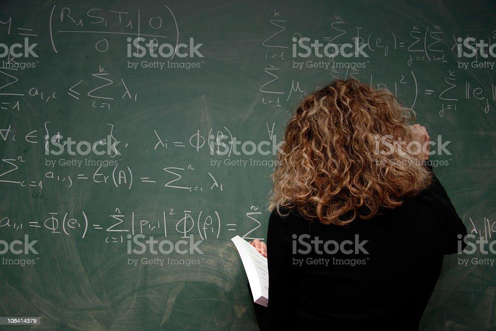professor writing equations on blackboard royalty-free stock photo