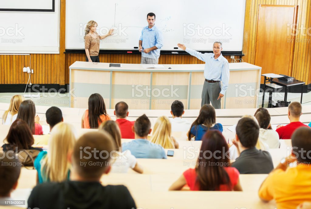 Professors and assistants giving a lecture. royalty-free stock photo
