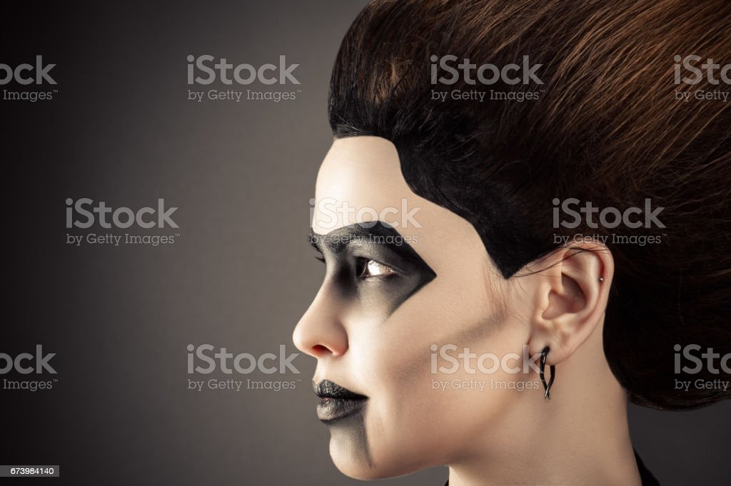 profile face woman with magnificent hair and dark make-up stock photo