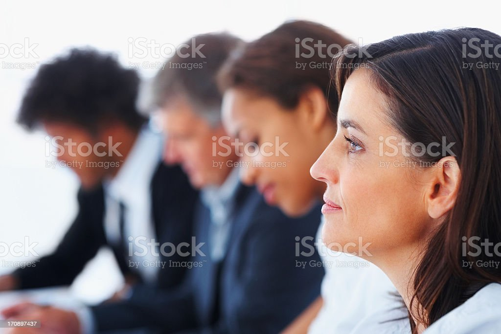 Profile image of a business woman with other colleagues at the back stock photo
