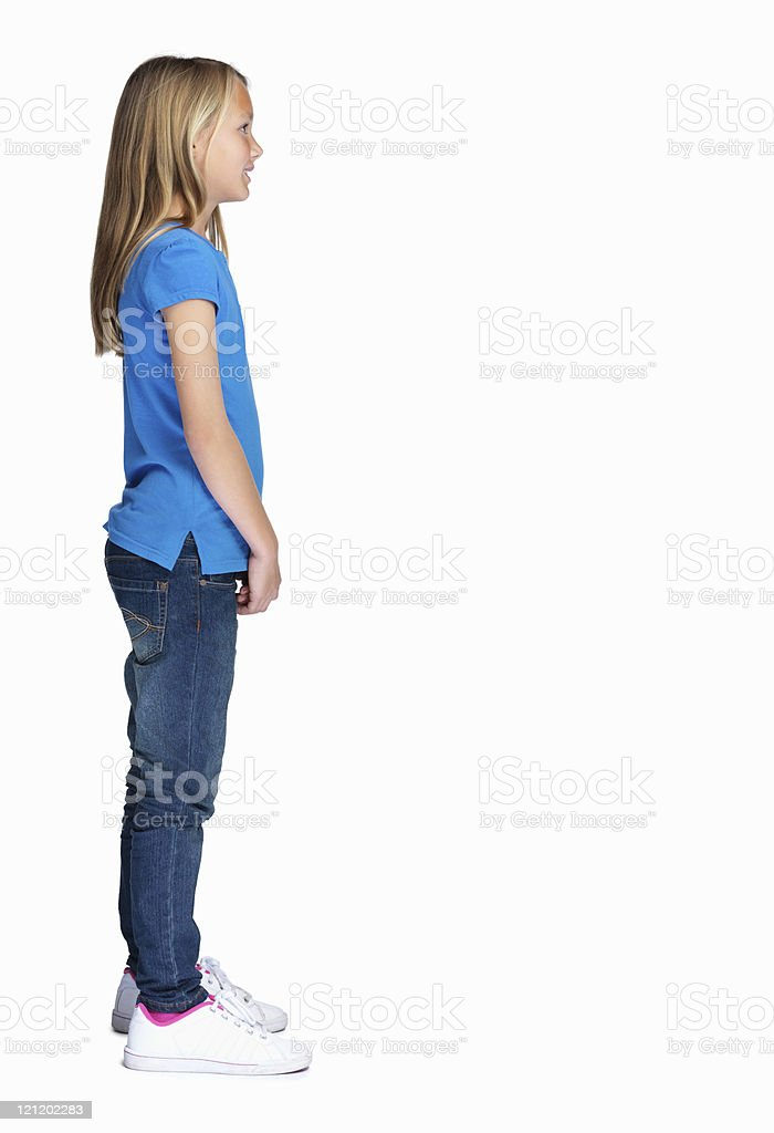 Profile image of a pretty little girl standing against white royalty-free stock photo