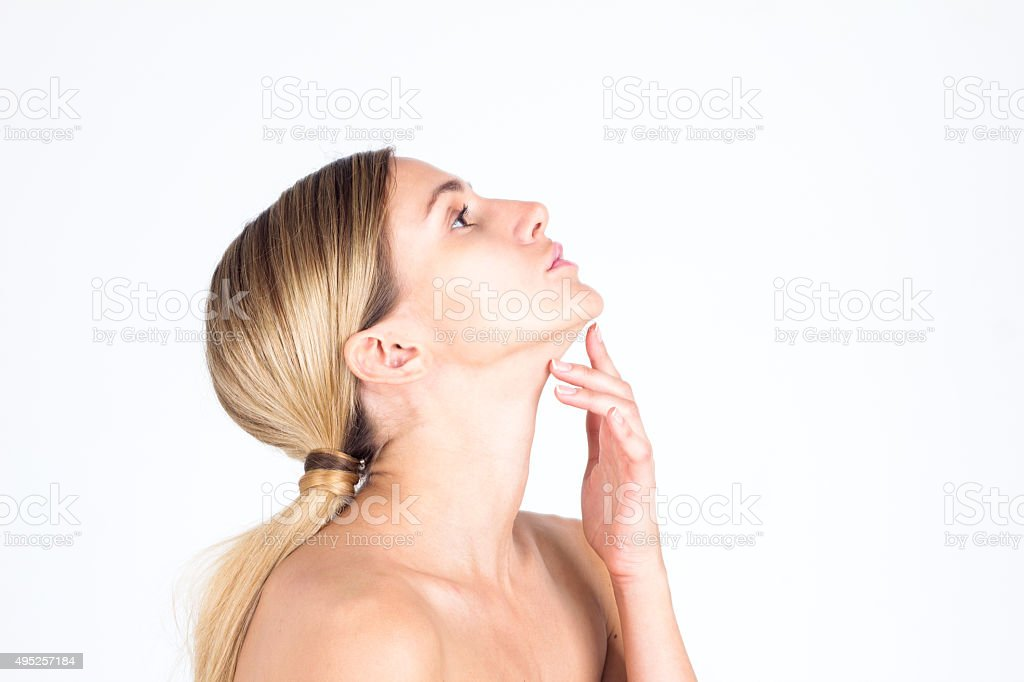 Profile of a beautiful young woman with outstretched neck stock photo