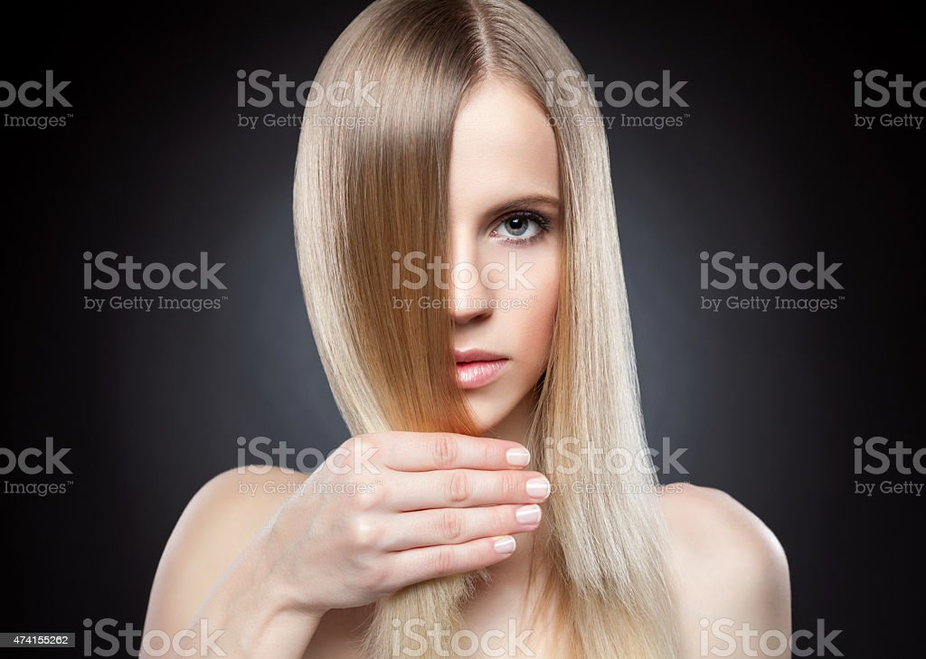 Profile of a beauty with long straight hair stock photo