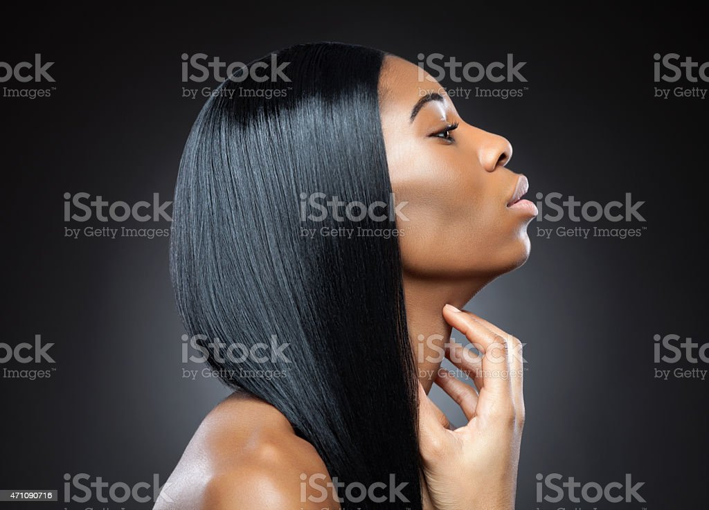 Profile of a black beauty with perfect straight hair stock photo