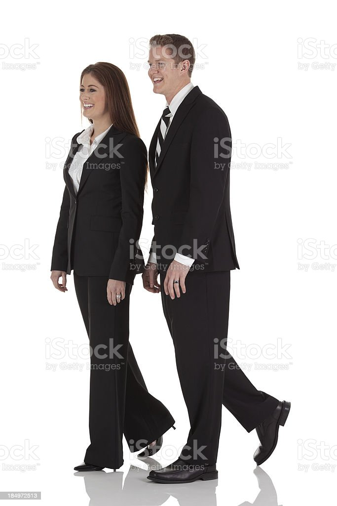 Profile of a business couple laughing royalty-free stock photo