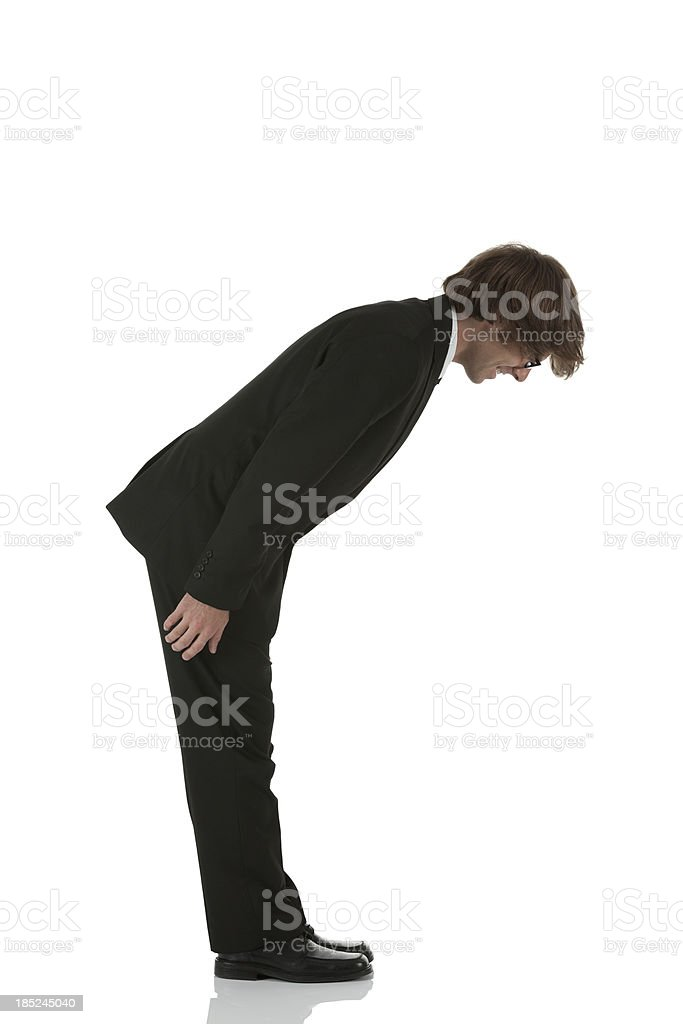 Profile of a businessman bowing stock photo
