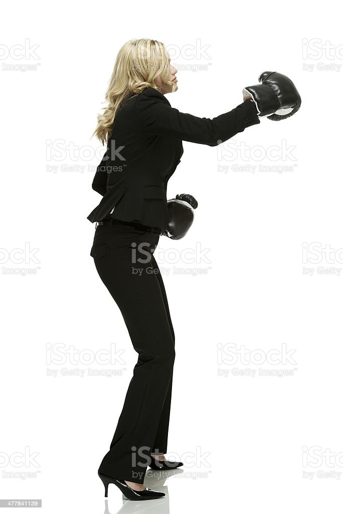 Profile of a businesswoman boxing royalty-free stock photo