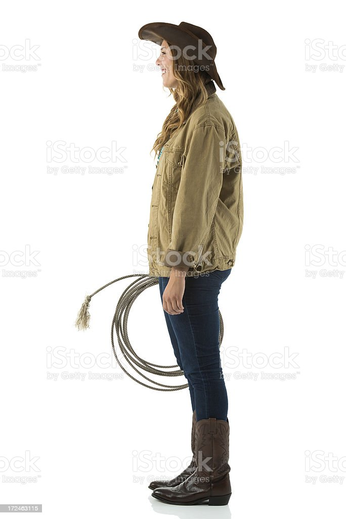 Profile of a cowgirl with lasso royalty-free stock photo