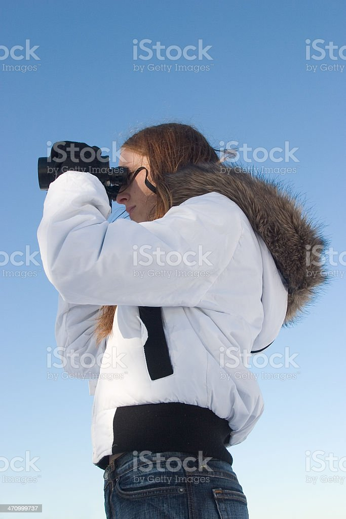 Profile of a girl with binoculars royalty-free stock photo