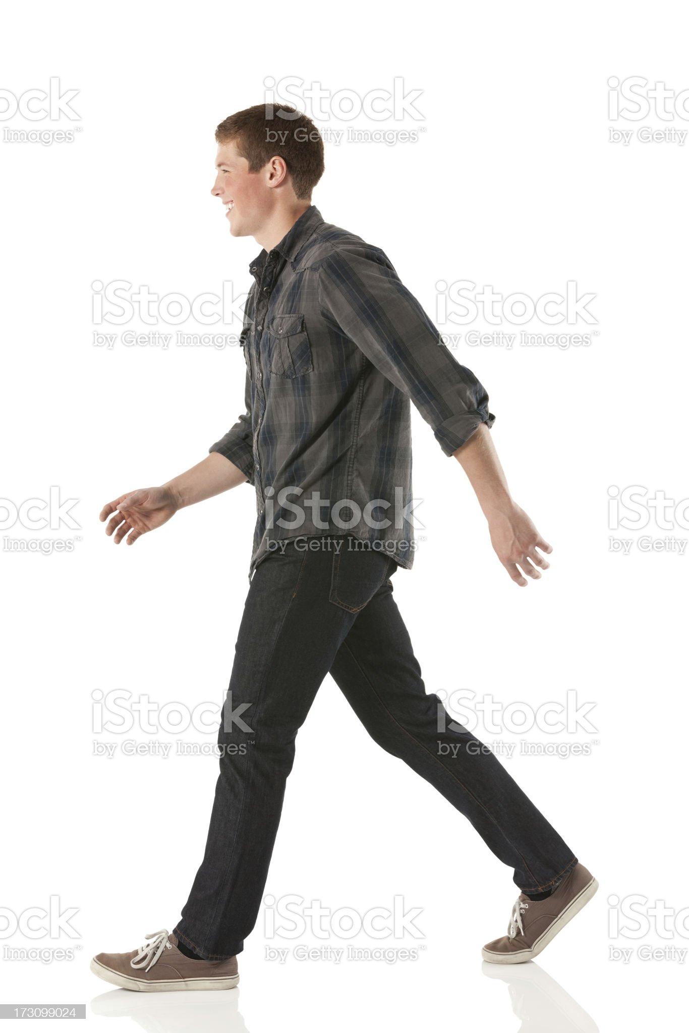 Profile of a happy man walking royalty-free stock photo
