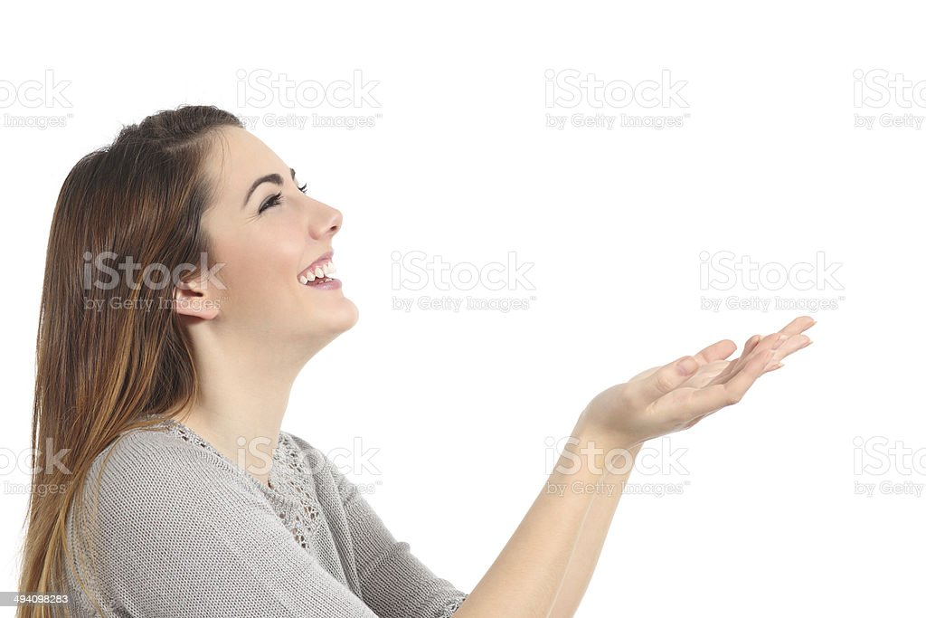 Profile of a happy woman holding something blank stock photo