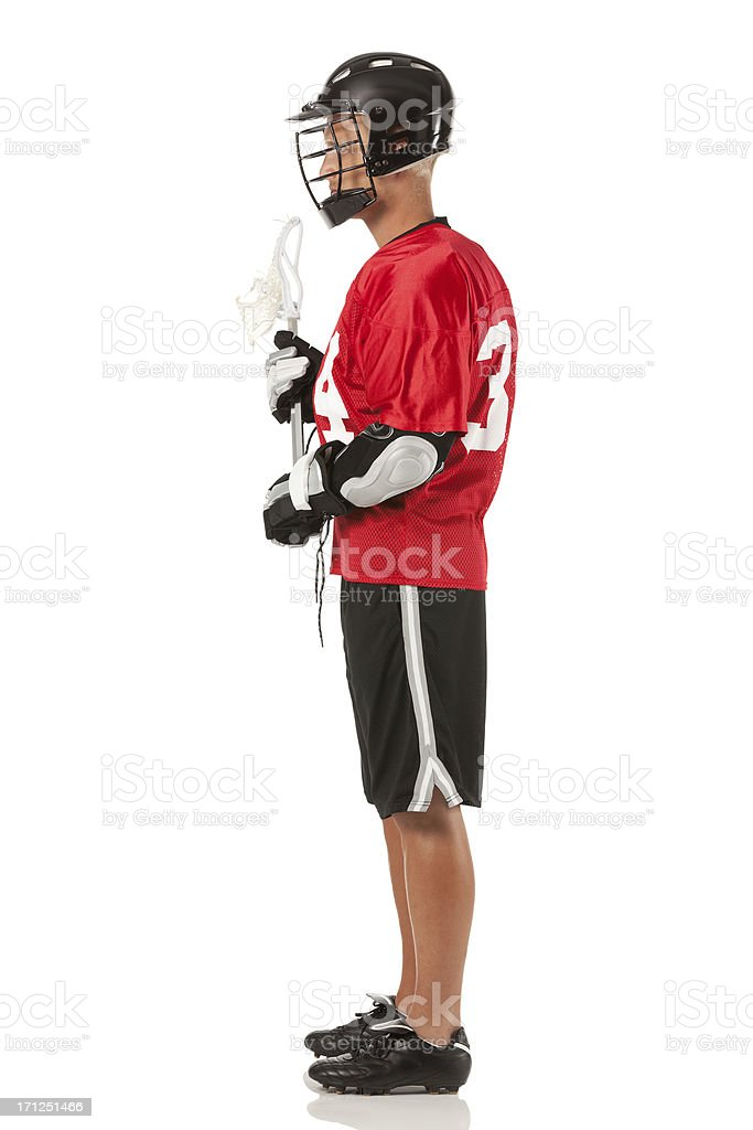 Profile of a lacrosse player standing stock photo
