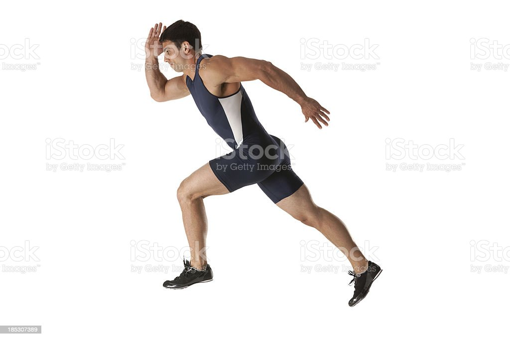 Profile of a male athlete running stock photo