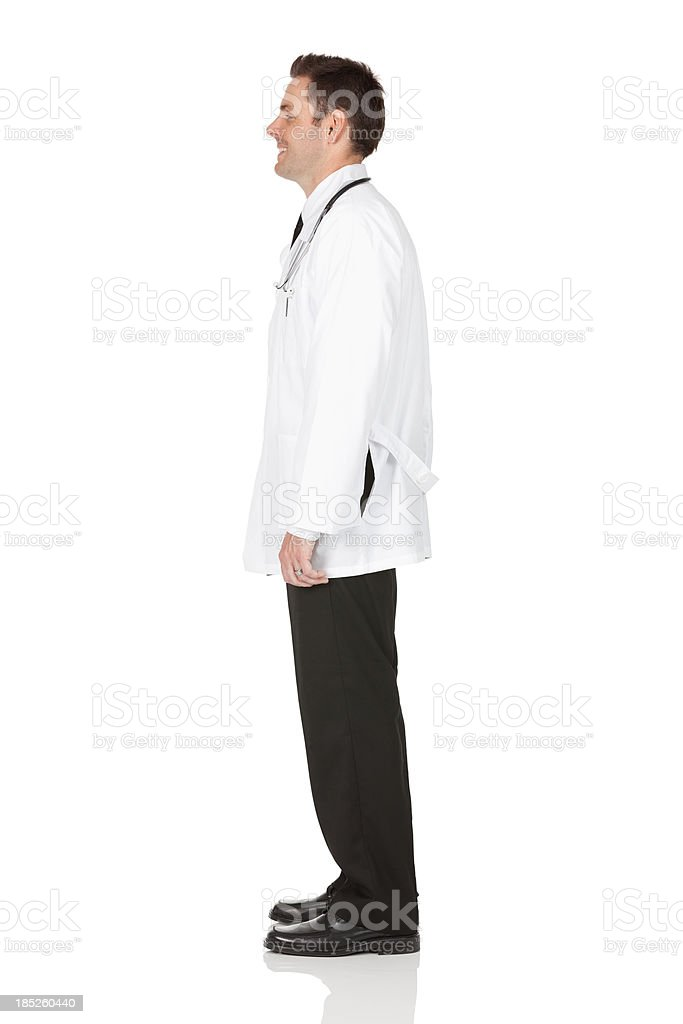Profile of a male doctor standing stock photo