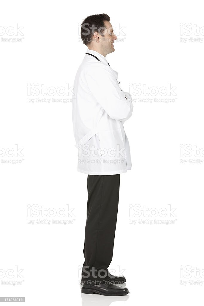 Profile of a male doctor standing with his arms crossed stock photo
