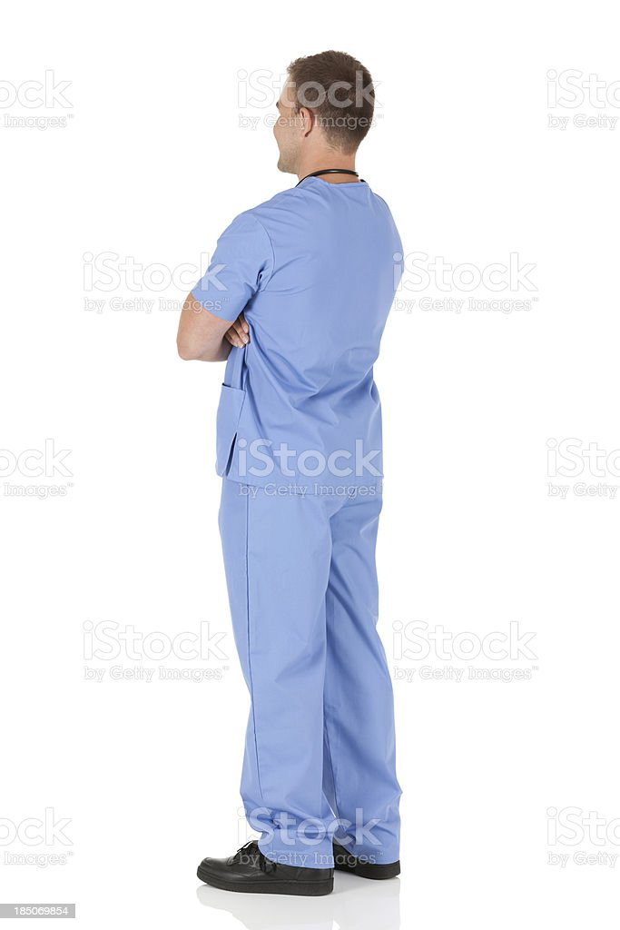 Profile of a male nurse standing with arms crossed royalty-free stock photo