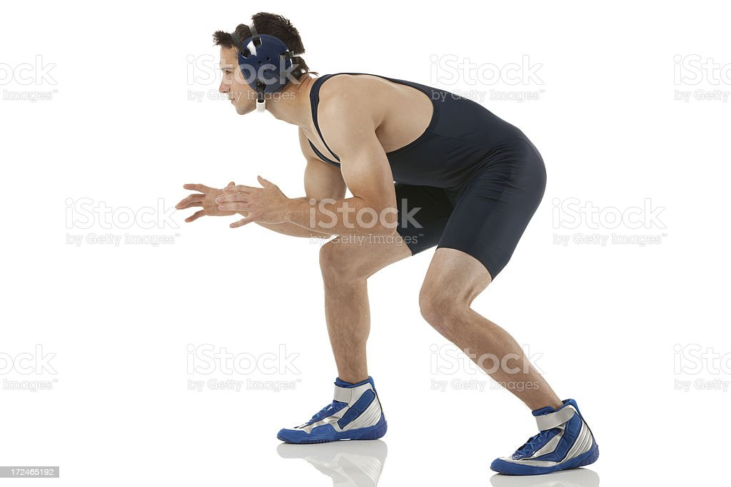 Profile of a male wrestler in action royalty-free stock photo