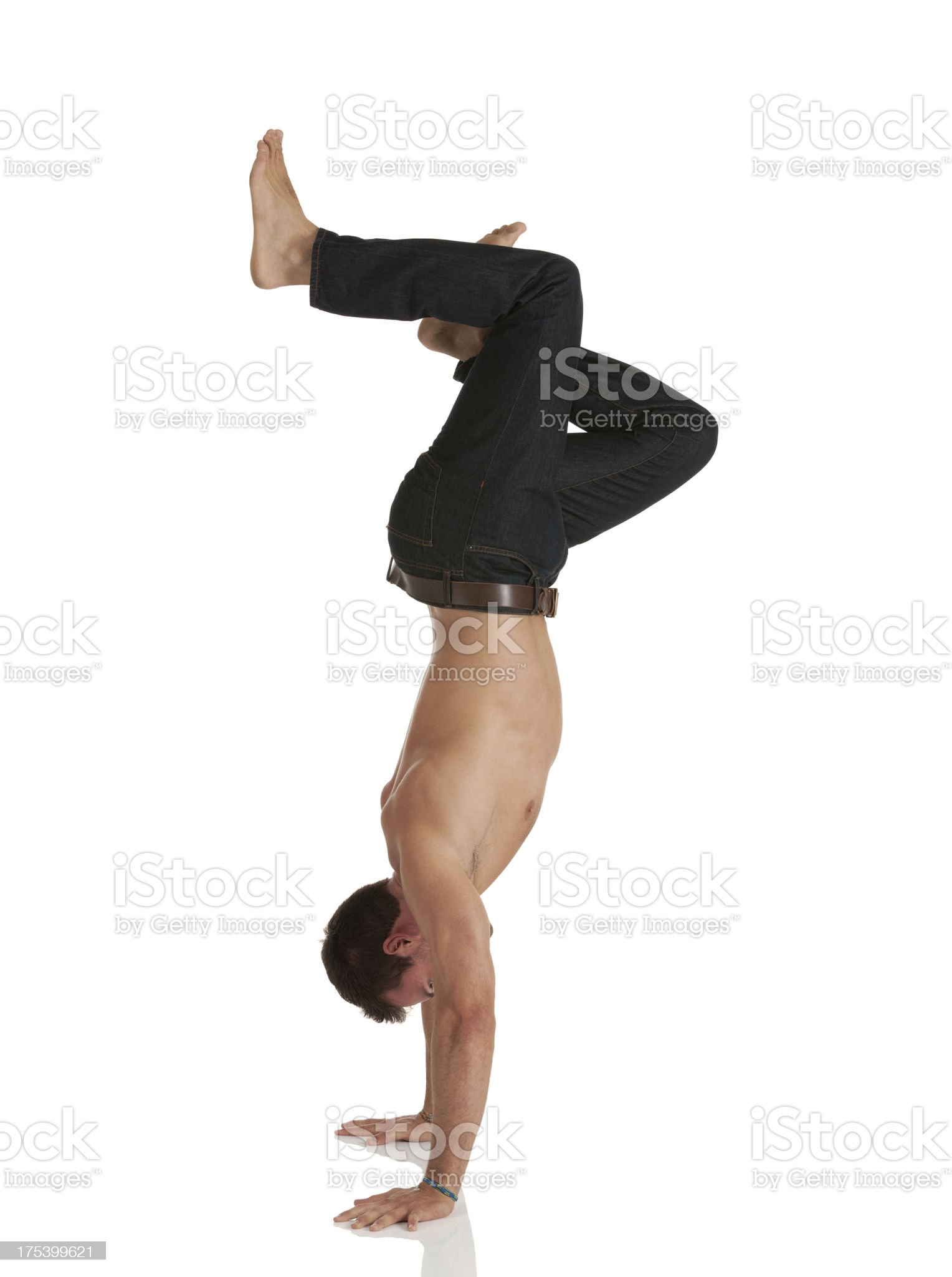 Profile of a man doing handstand royalty-free stock photo