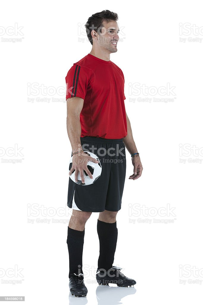 Profile of a man holding football royalty-free stock photo