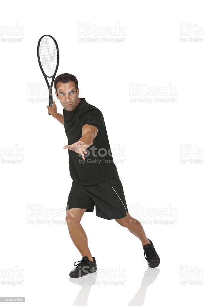 Profile of a man playing tennis royalty-free stock photo