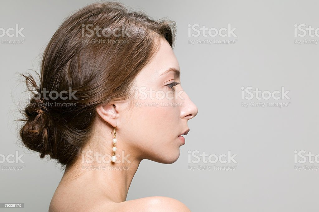 Profile of a young woman stock photo