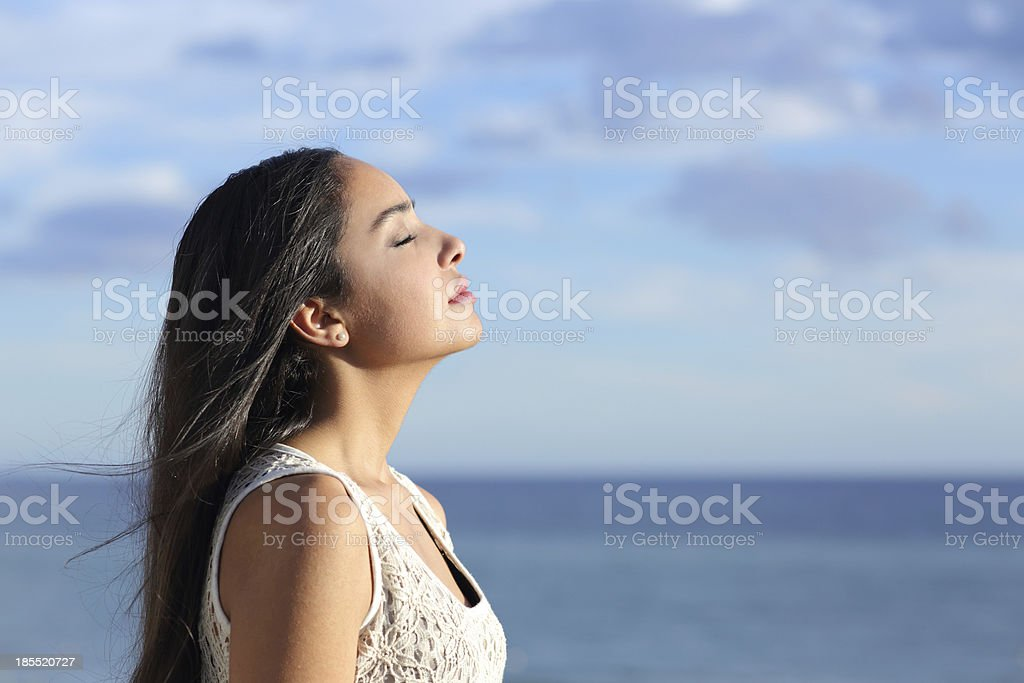 Profile of an arab woman breathing fresh air stock photo