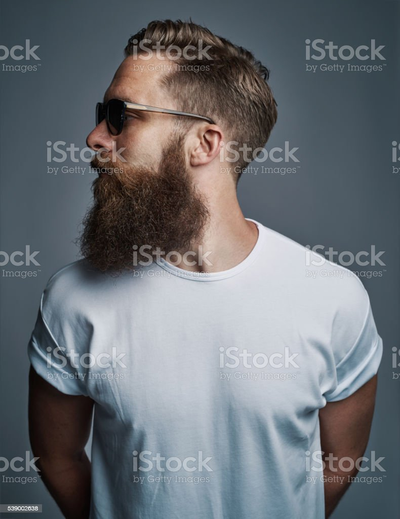 Profile of bearded handsome man with sunglasses stock photo