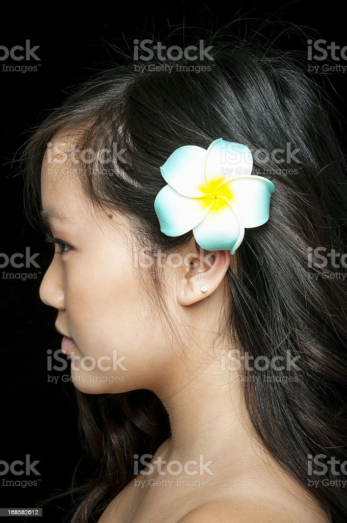 Profile of Beautiful Asian Woman with Flower in Hair royalty-free stock photo