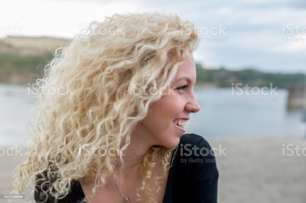 Profile of beautiful happy woman outdoors. stock photo